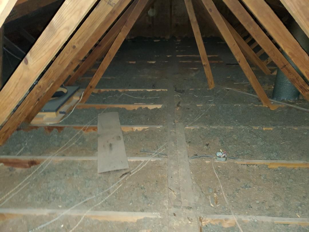 Inspecting insulation levels in Godfrey, IL and providing a free estimate for blown in cellulose attic insulation.
