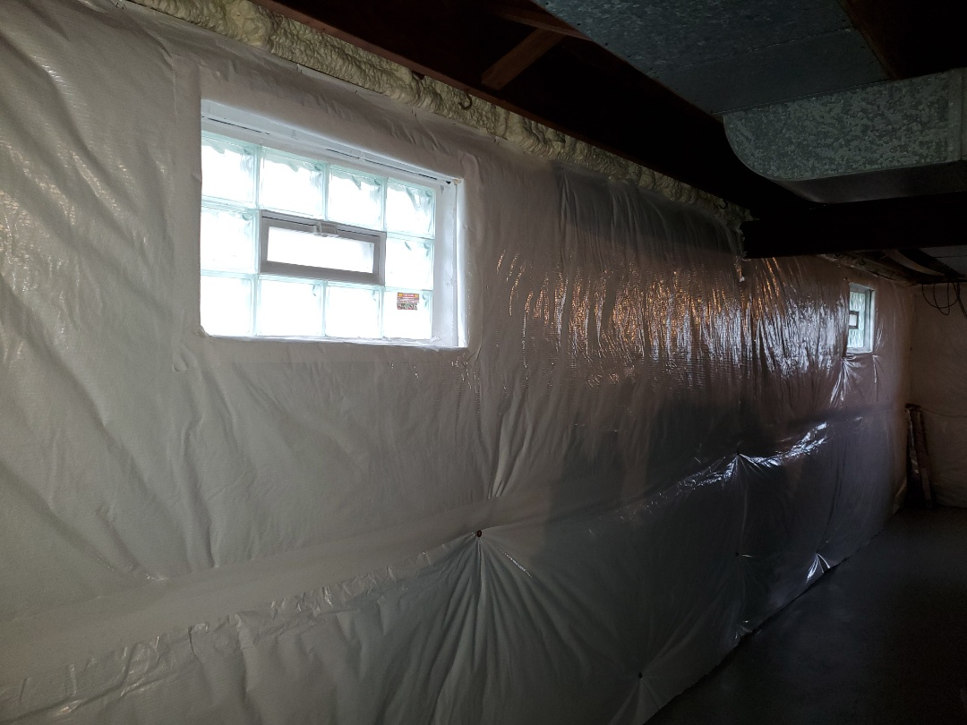 Installing basement wall insulation in Belleville, IL.