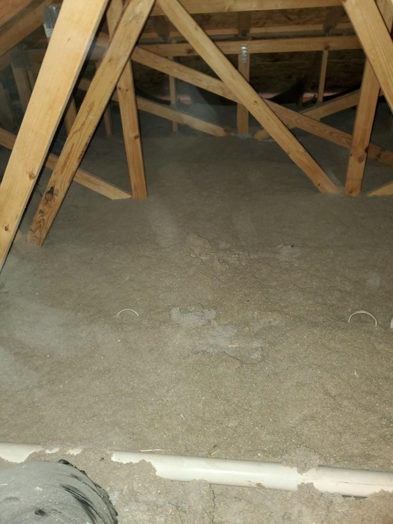 Providing a free estimate for blown in cellulose attic insulation.