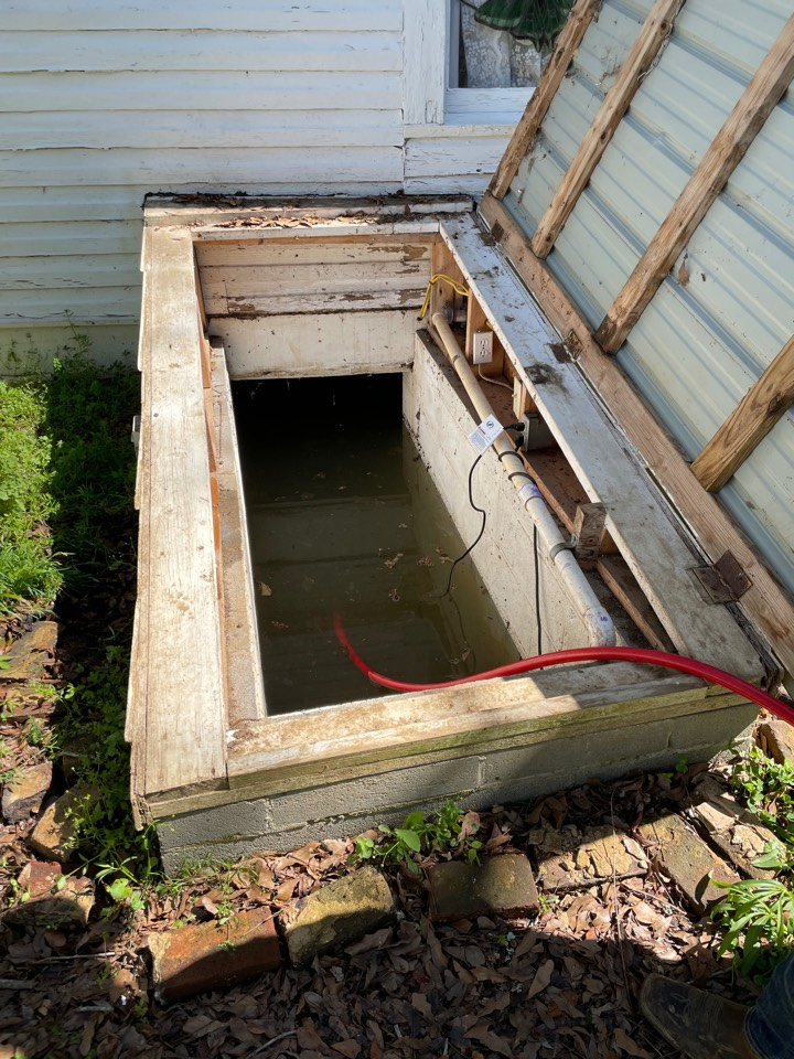 Langston, AL - Pumping out flooded Root Cellar