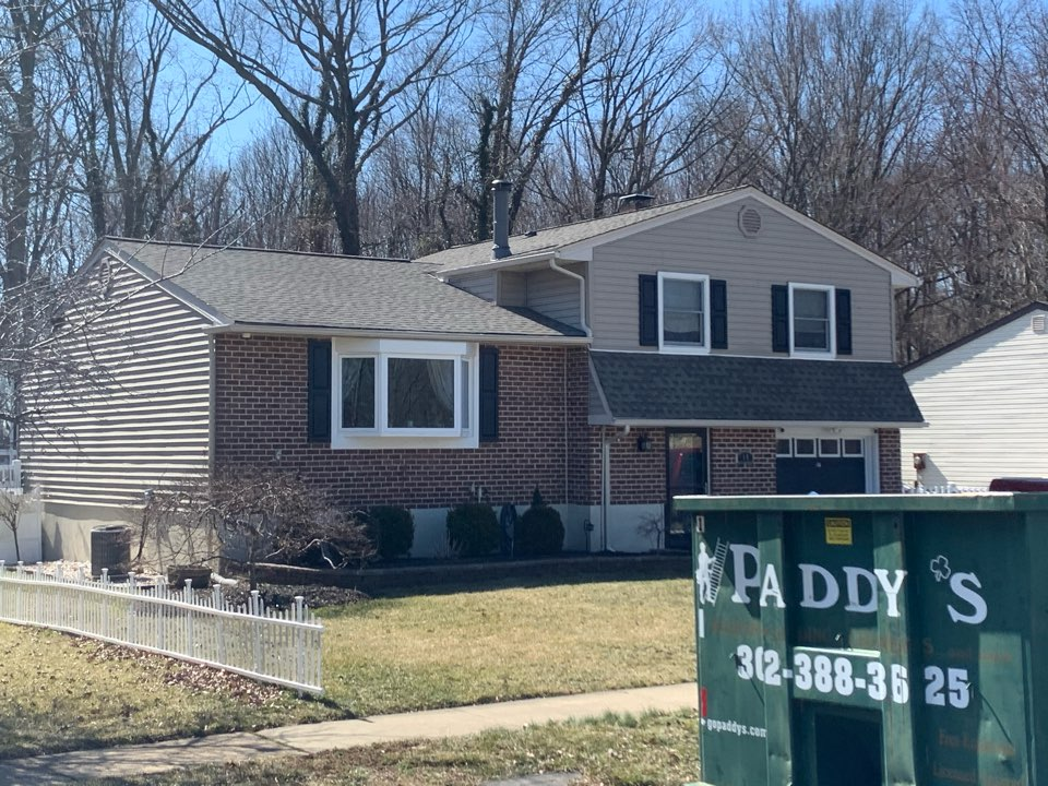 Newark, DE - Roof Replacement - GAF Timberline HDZ 50 year lifetime Weather wood shingles with custom bent black metal counter flashing around the chimney and all pipes painted to match the roof