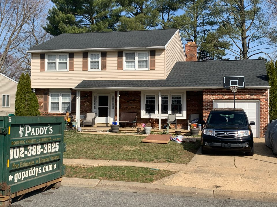 New Castle, DE - Roof Replacement - GAF Timberline HDZ 50 year lifetime Charcoal shingles with custom bent black metal chimney counter flashing