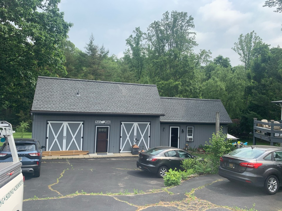 Wilmington, DE - Roof Replacement - GAF Timberline HDZ 50 year lifetime Pewter Gray shingles with custom bent black counter flashing and painted pipes/vents to match the roof