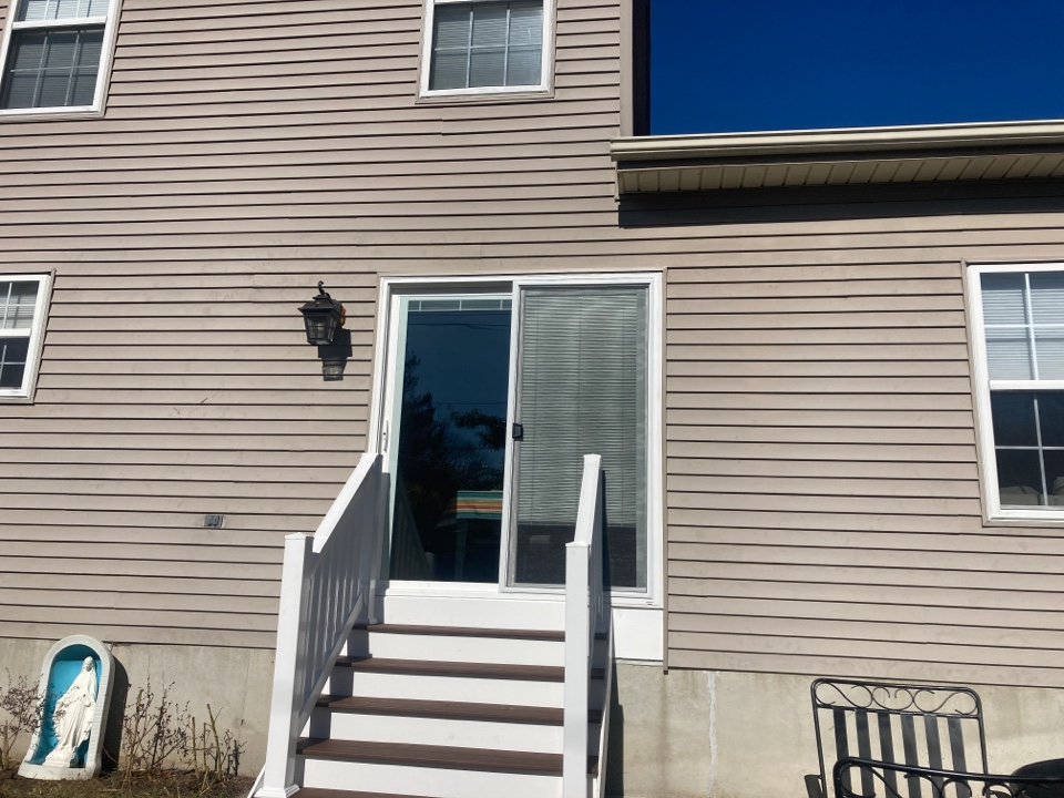 Wilmington, DE - Replaced patio sliding door, installed window flashing tape, removed and reinstalled siding.