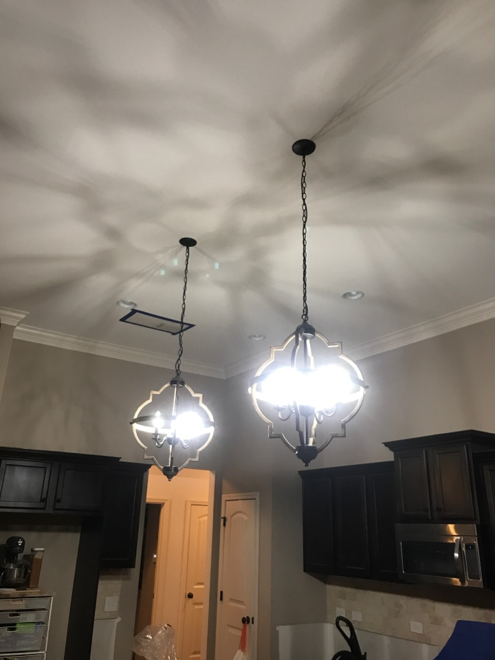 Cumming, GA - Tech replaced 3 chandeliers and installed an outlet in new location for flat screen TV. Tech installed a new whole house surge protector