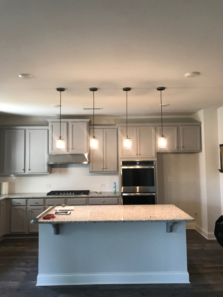 Installation of ceiling fans and pendant light fixtures over kitchen Island
