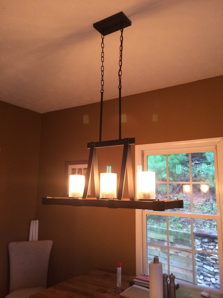 Dahlonega, GA - Installing new light fixture over dinning room table.