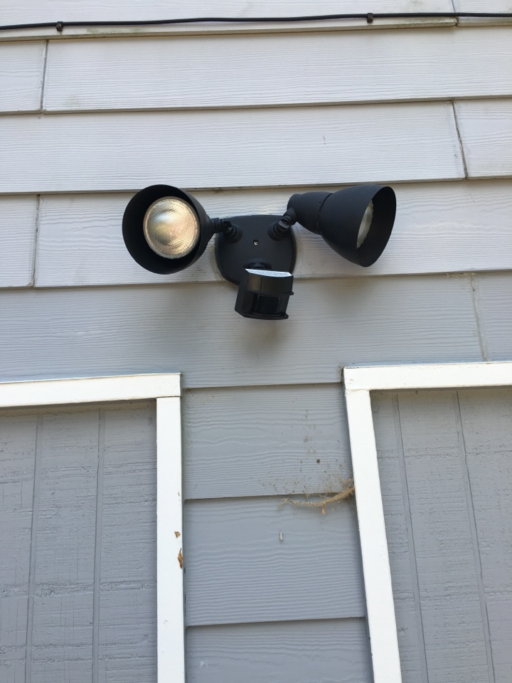 Replace outdoor motion flood light with a weather proof box.  Replace front porch on porch.