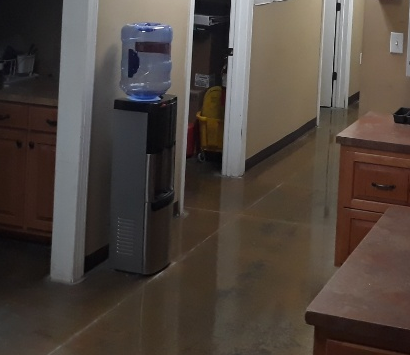 Working at an construction site office commercial cleaning floors bathrooms kitchen dusting and wiping of desks and computers vacuum and trash covid 19 prevention