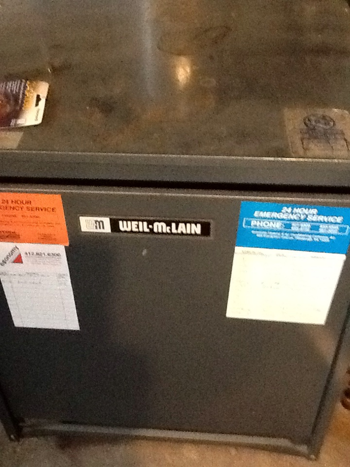 Pittsburgh, PA - Prefroming a precision tune up on a  Weil McLain boiler