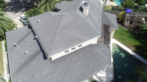 Melbourne, FL - Installing a GAF Timberline HD Charcoal shingle on a two story home and use GAF Weatherwatch underlayment on the entire roof.