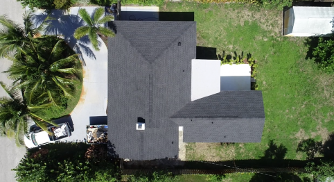 """West Palm Beach, FL - Replacing current asphalt shingles with GAF Timberline® HD® Shingles with StainGuard Protection Charcoal. As well as installing white 6"""" gutters with 3x4 downspouts around the house"""