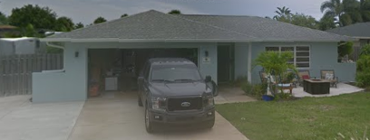 Satellite Beach, FL - Removing all shingles that were damaged from a hail storm and replacing the roof with Owens Corning ProEdge® Hip & Ridge Standard Shingles in Pacific Wave color.