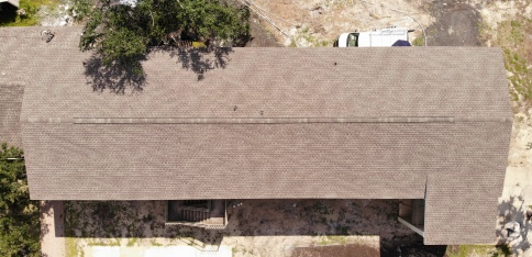 Panama City, FL - Reroofing a dual-story Church building with GAF Timberline® HD® Shingles in a Barkwood color. We are working on restoring the shingles on multiple awnings as well.