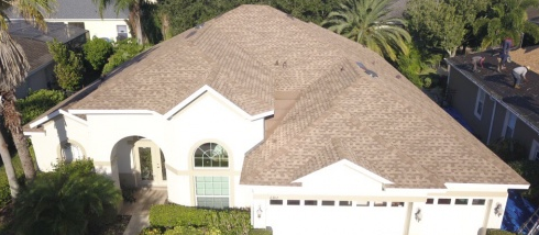 Orlando, FL - Completing a reroofing project in which we are installing GAF Timberline® HD® Shingles with StainGuard Protection in Shakewood color. At the same time, the crew is replacing the homes worn eavesdrops with new gutters and downspouts.