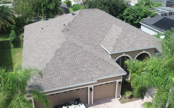 Orlando, FL - Completing a GAF Golden Pledge full re-roofing job in which old asphalt shingles are being replaced with GAF Timberline Ultra HD Shingles with StainGuard Plus Protection in a Weathered Wood color.