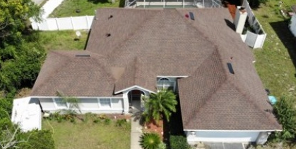 Deltona, FL - Replacing old asphalt shingles with new GAF Timberline HD Shingles in a brown color. At the same time, the crew is removing any rotten sheets of plywood and replacing them with new wood decking.