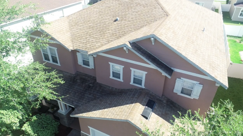 Orlando, FL - Completing a new GAF Timberline® HD® Shingles with StainGuard Protection in a Charcoal color after the client's asphalt shingle roof was damaged from a bad storm.