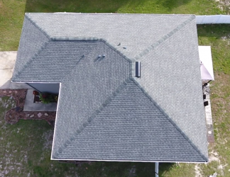Deltona, FL - Installing a new GAF Timberline HD SG SLATE roof on a home that was damaged by a storm with high winds. In addition to the new asphalt shingles, the crew is placing a layer of GAF StormGuard underlayment in leak-prone areas for protection against future storms.