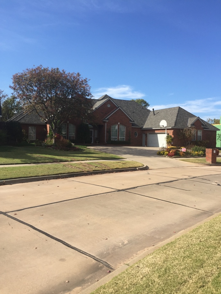 Norman, OK - Installed a CertainTeed Grand Manor Shingle in the Weathered Wood Color.  Installed the roof by hand nailing to provide great craftsmanship for a beautiful designer shingle.