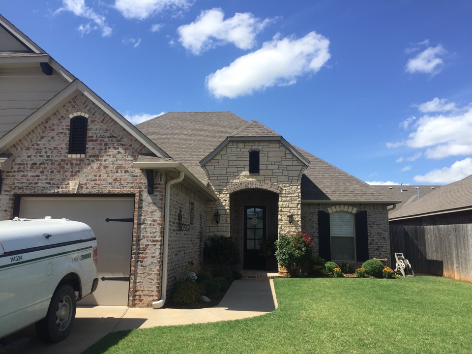 Moore, OK - Repaired missing 3-tab ridge on new construction for a previous customer in Moore, Oklahoma.
