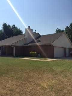 Yukon, OK - These clients in Yukon, OK chose a pearl color siding by Crane for their house.