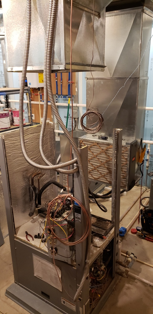 Delaware, OH - Performing routine maintenance on WaterFurnace 7 Series Geothermal system