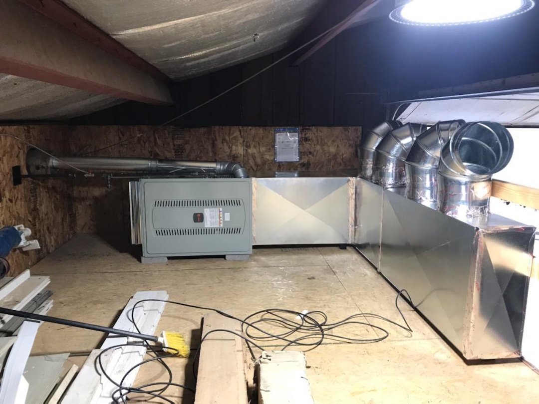 Sunbury, OH - Installing Trane furnace in warehouse mezzanine.
