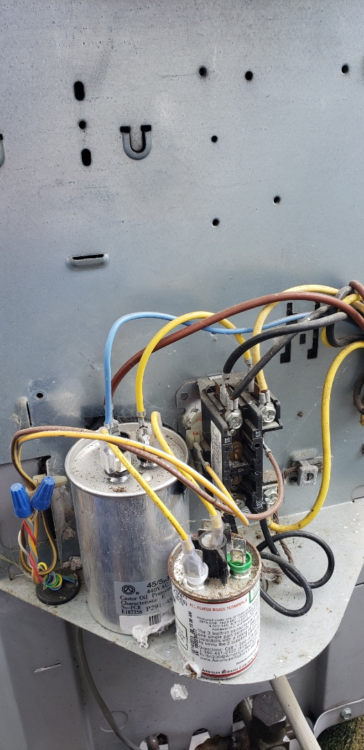 Delaware, OH - Cleaning cobwebs and insects from air conditioner electrical compartment