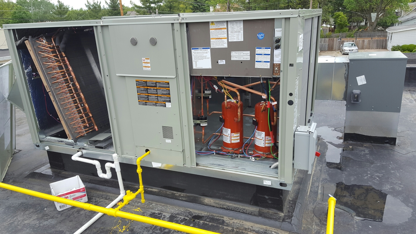 Hilliard, OH - Wiring up rooftop package units and firing off for the first time