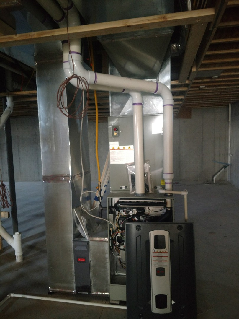 Powell, OH - Installing Trane S9V2 gas furnace in new construction home near Powell.