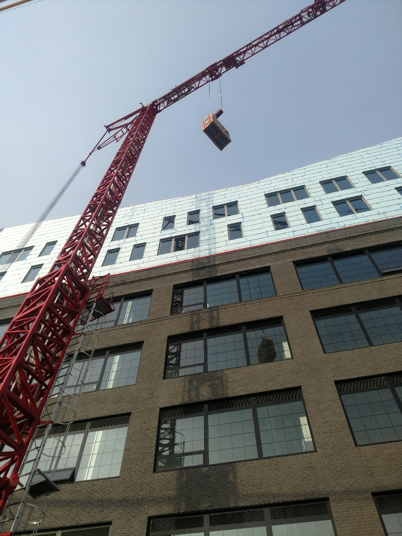 Columbus, OH - Lifting air conditioners to roof at The View on Grant.