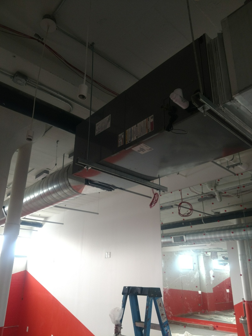Columbus, OH - Installing furnace in fitness room at the View on Grant.