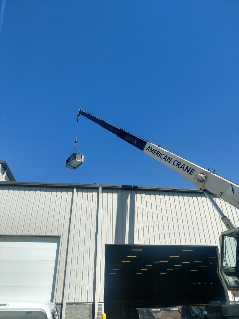 Sunbury, OH - Installing Trane roof top unit on building in Sunbury.