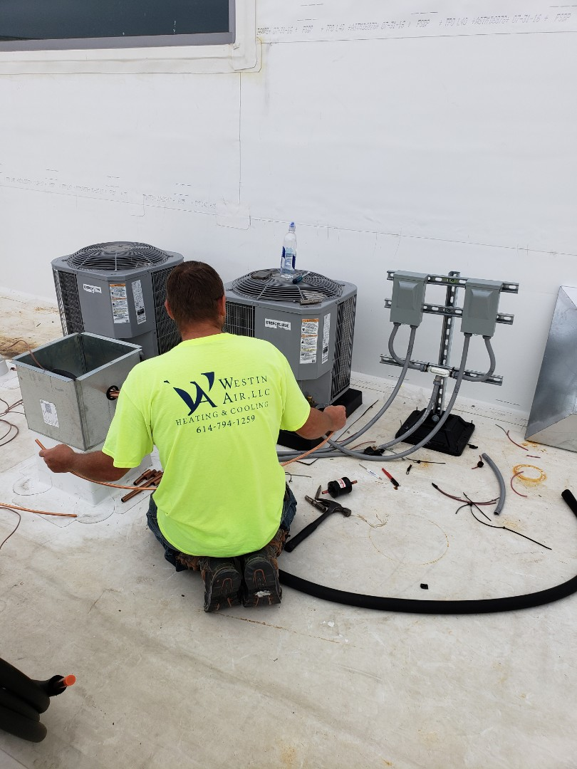 Columbus, OH - Installing Tempstar air conditioners at The View on Grant.
