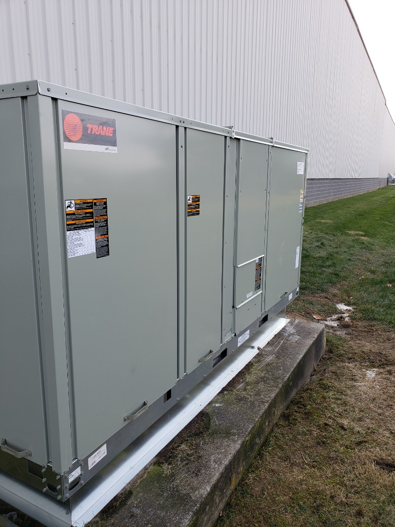 Sunbury, OH - Installing Trane Voyager package unit at Ohashi in Sunbury.