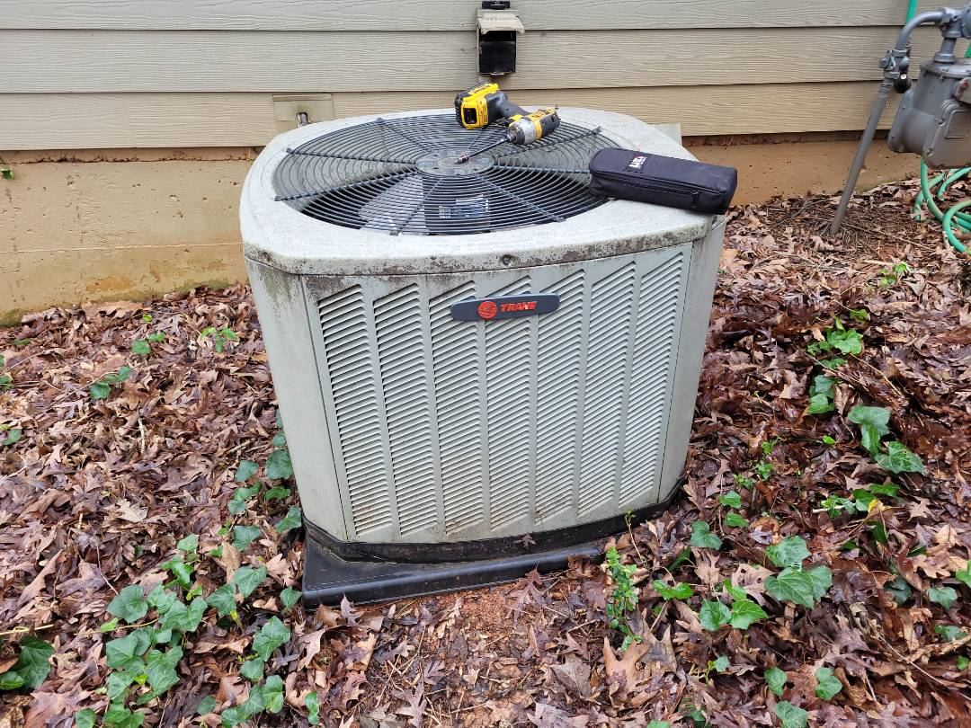 Performing Top Shelf Maintenance program on HVAC system