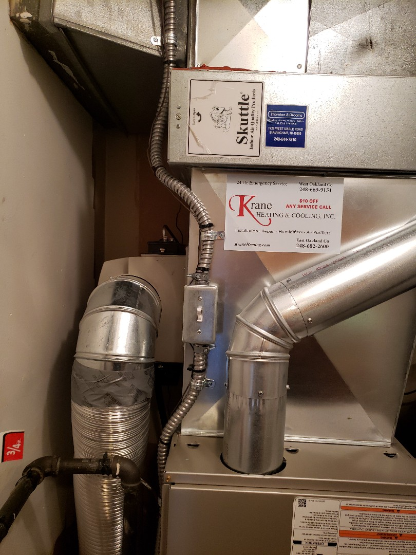 Bloomfield Hills, MI - Changed a humidifier pad on a hard to get to General 1042 humidifier