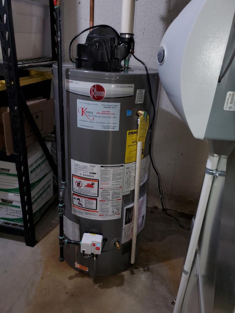Install a 50 gallon Rheem water heater