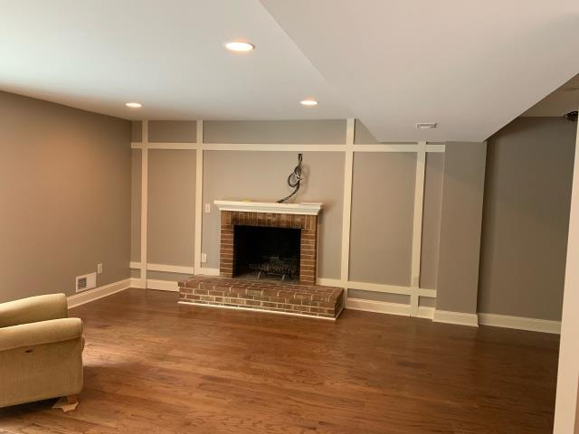 Bethesda, MD - Remodeling the Lower Level of a Home...hidden door constructed with the trim design on each side of the fireplace
