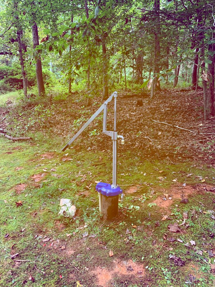 Installed customer supplied hand pump for well.