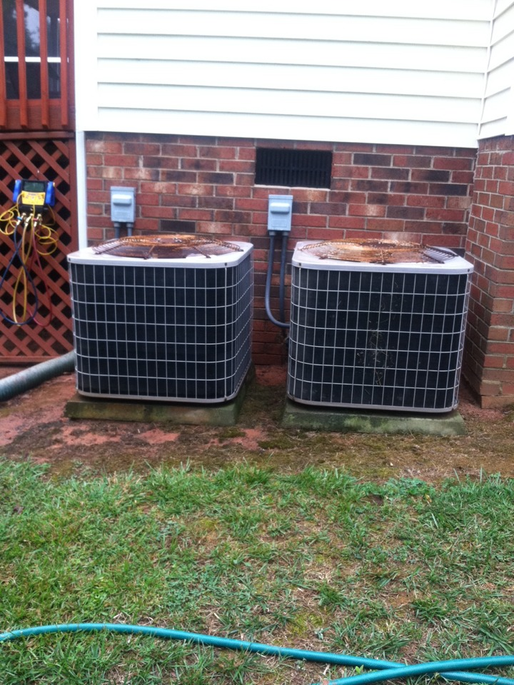 Inman, SC - Performing a summer tune up on two heat pumps. Not sure if u can see. The condenser on right has been cleaned, the one on the left has not.