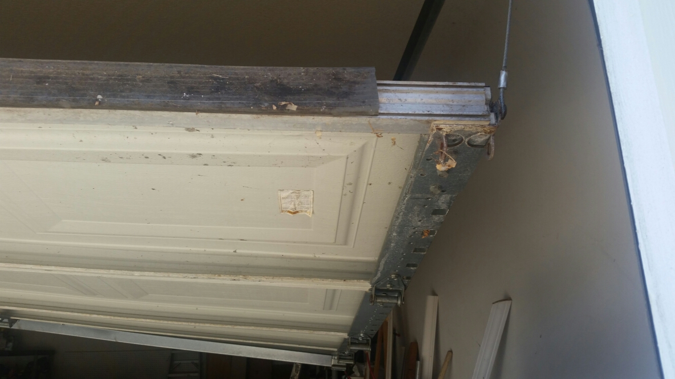 Cary, NC - Repairing a garage door that fell out of its track.