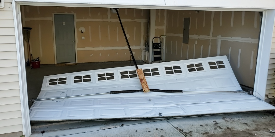Durham, NC - Replacing and Amarr garage door that was struck by vehicle in Durham, NC.