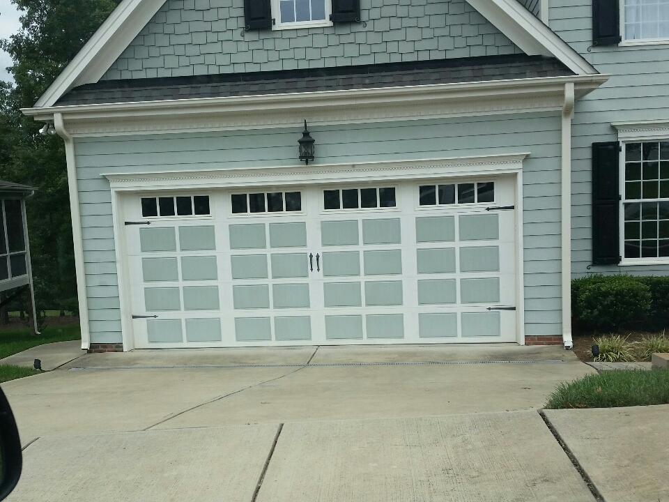 Holly Springs, NC - Replacing a broken torsion spring on a carriage style garage door.