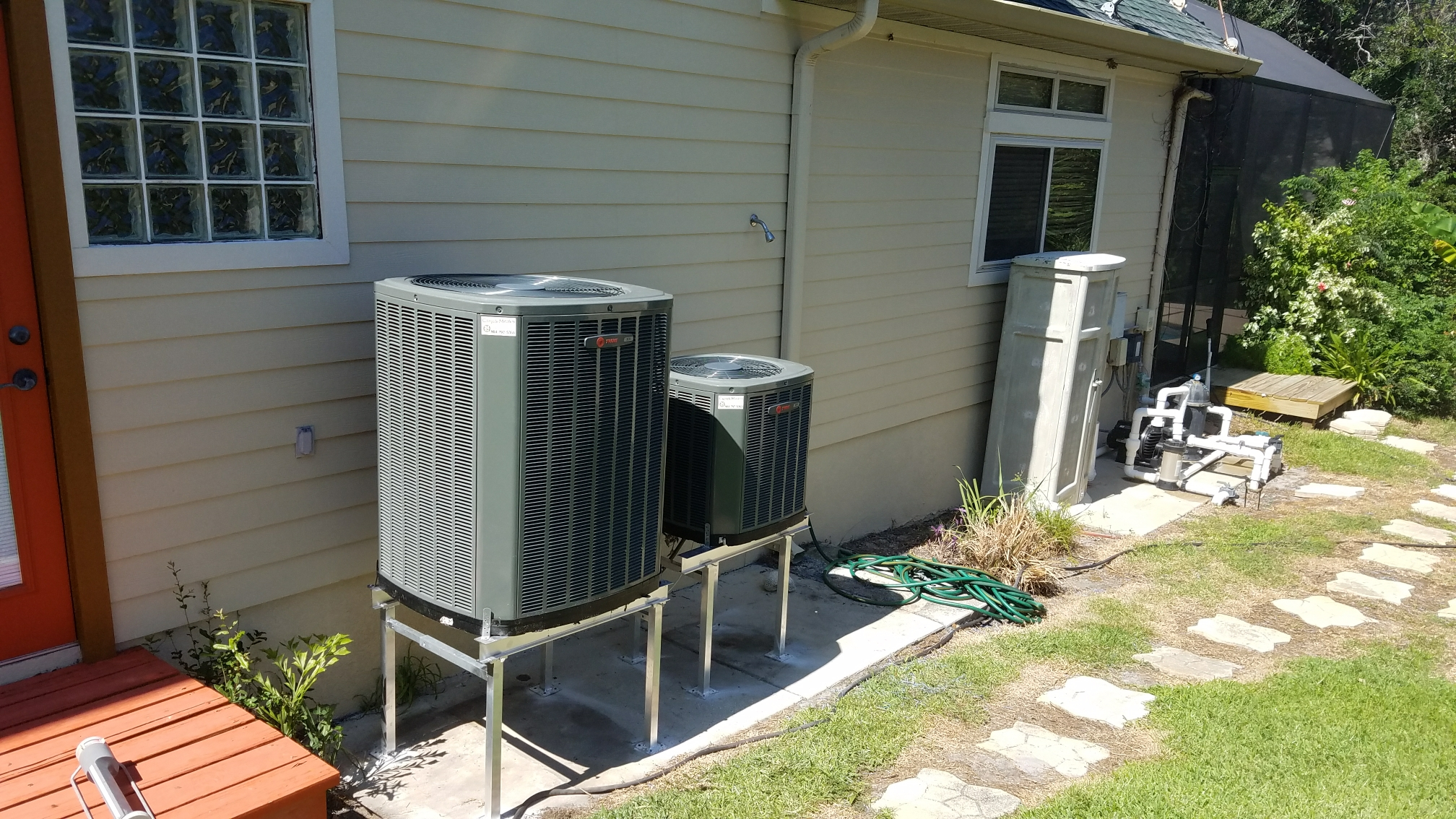 Saint Augustine, FL - Raised 2 trane condensers on metal stands