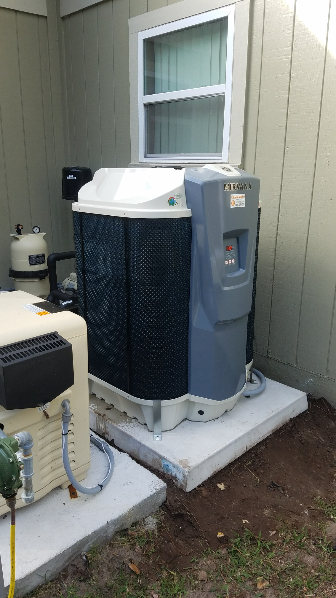 St. Augustine, FL - Installed new heat pump pool heater in line with gas pool heater