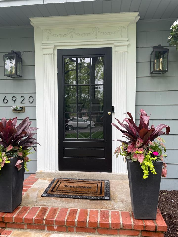 Kansas City, MO -  Freshly painted front door and new wooden storm door