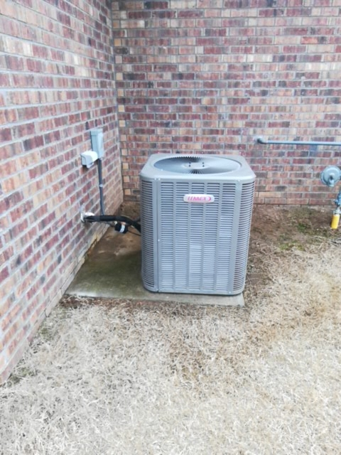 Centerton, AR - Doing preventative maintenance on an air conditioner.