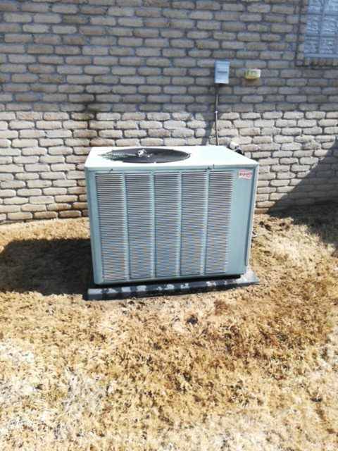 Bentonville, AR - Doing preventive maintenance on an air conditioner.